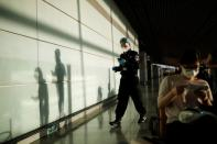 Security guard wearing protective gear is seen at Beijing Capital International Airport