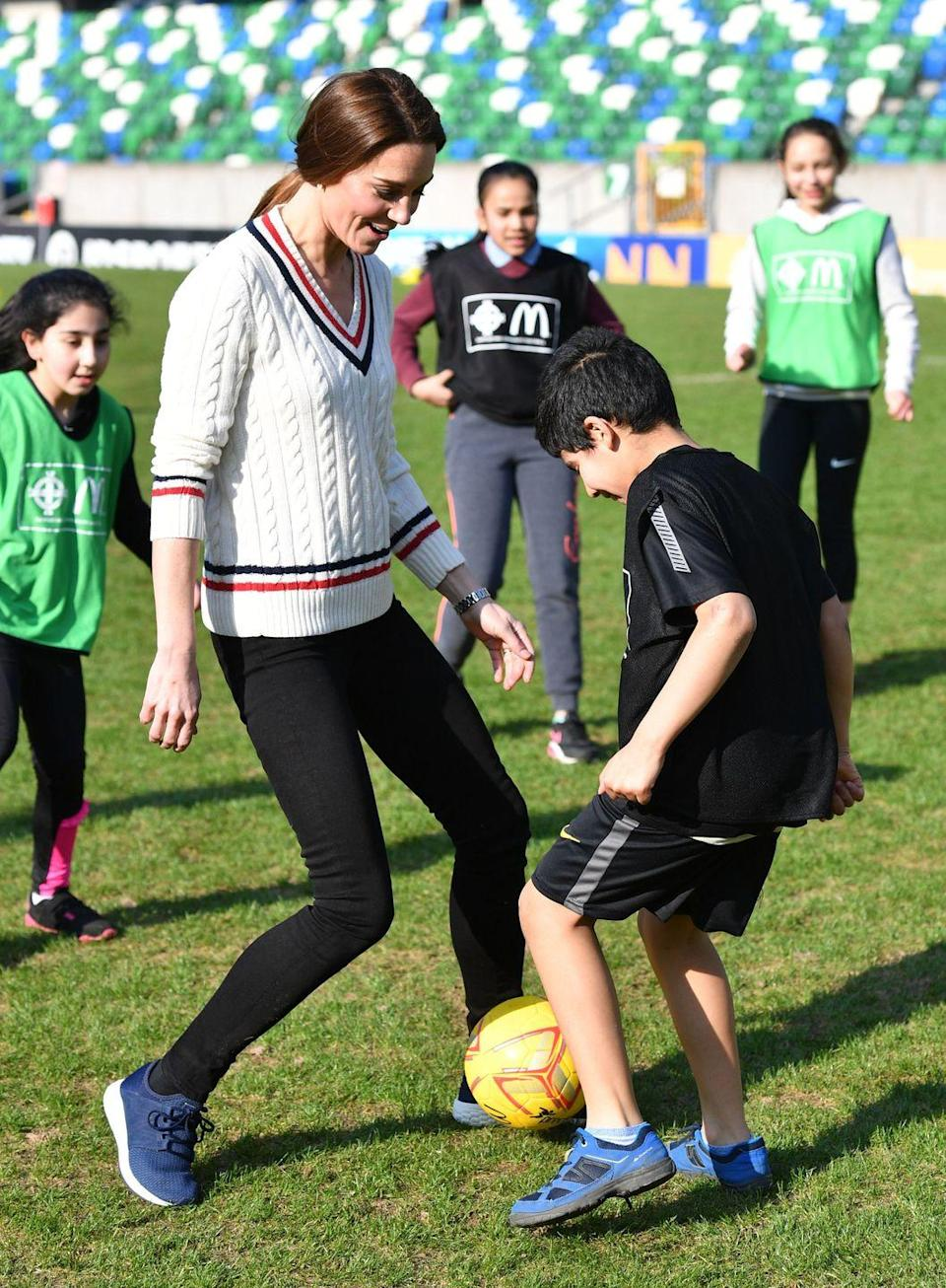"""<p>The athletic Duchess played soccer (known in the UK as football) with children during a visit to the National Stadium in <a href=""""https://www.townandcountrymag.com/society/tradition/g26550415/prince-william-kate-middleton-northern-ireland-visit-photos/"""" rel=""""nofollow noopener"""" target=""""_blank"""" data-ylk=""""slk:Belfast, Ireland,"""" class=""""link rapid-noclick-resp"""">Belfast, Ireland,</a> home of the Irish Football Association. </p>"""