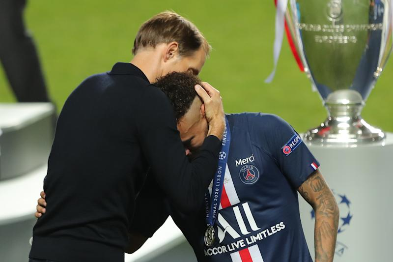 PSG superstar Neymar (right) was comforted by manager Thomas Tuchel after losing the UEFA Champions League final to Bayern Munich. (Miguel A. Lopes/Getty Images)