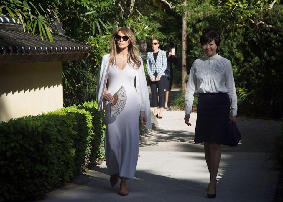 <p>The FLOTUS was seen wearing a long white dress and matching cardigan on a recent visit to the Morikami Museum and Japanese Gardens with Akie Abe, the wife of Prime Minister Shinzo Abe of Japan.</p>