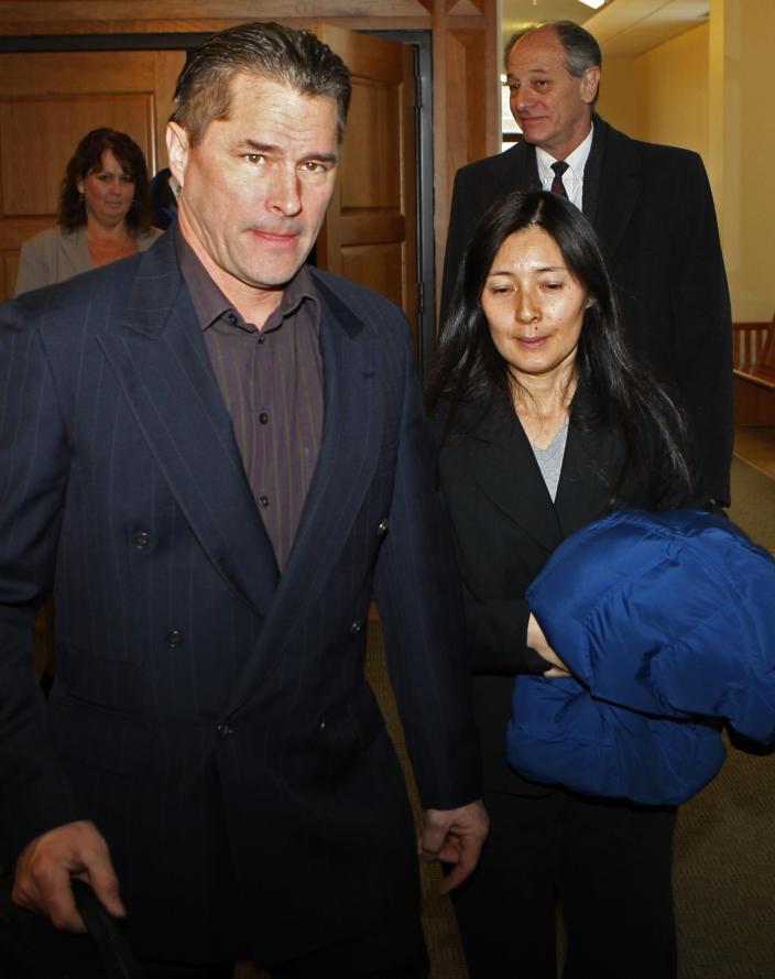 FILE - In this Dec. 23, 2009, file photo, Richard and Mayumi Heene leave court after sentencing, in Fort Collins, Colo. The couple convicted of criminal charges in the so-called balloon boy hoax that fascinated the country more than a decade ago was pardoned Wednesday, Dec. 23, 2020, by the governor of Colorado. (AP Photo/Ed Andrieski, File)
