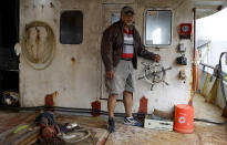 In this Tuesday, April 9, 2019, photo, fisherman and former politician Teisina Fuko on his fishing boat in Nuku'alofa, Tonga. China is pouring billions of dollars in aid and low-interest loans into the South Pacific, and even in the far-flung kingdom of Tonga there are signs that a battle for power and influence among much larger nations is heating up and could exact a toll. (AP Photo/Mark Baker)