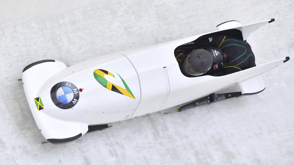 Jazmine Fenlator-Victorian and Carrie Russell of Jamaica speed down the track at the women's bobsled World Cup race in Innsbruck. (AP Photo)