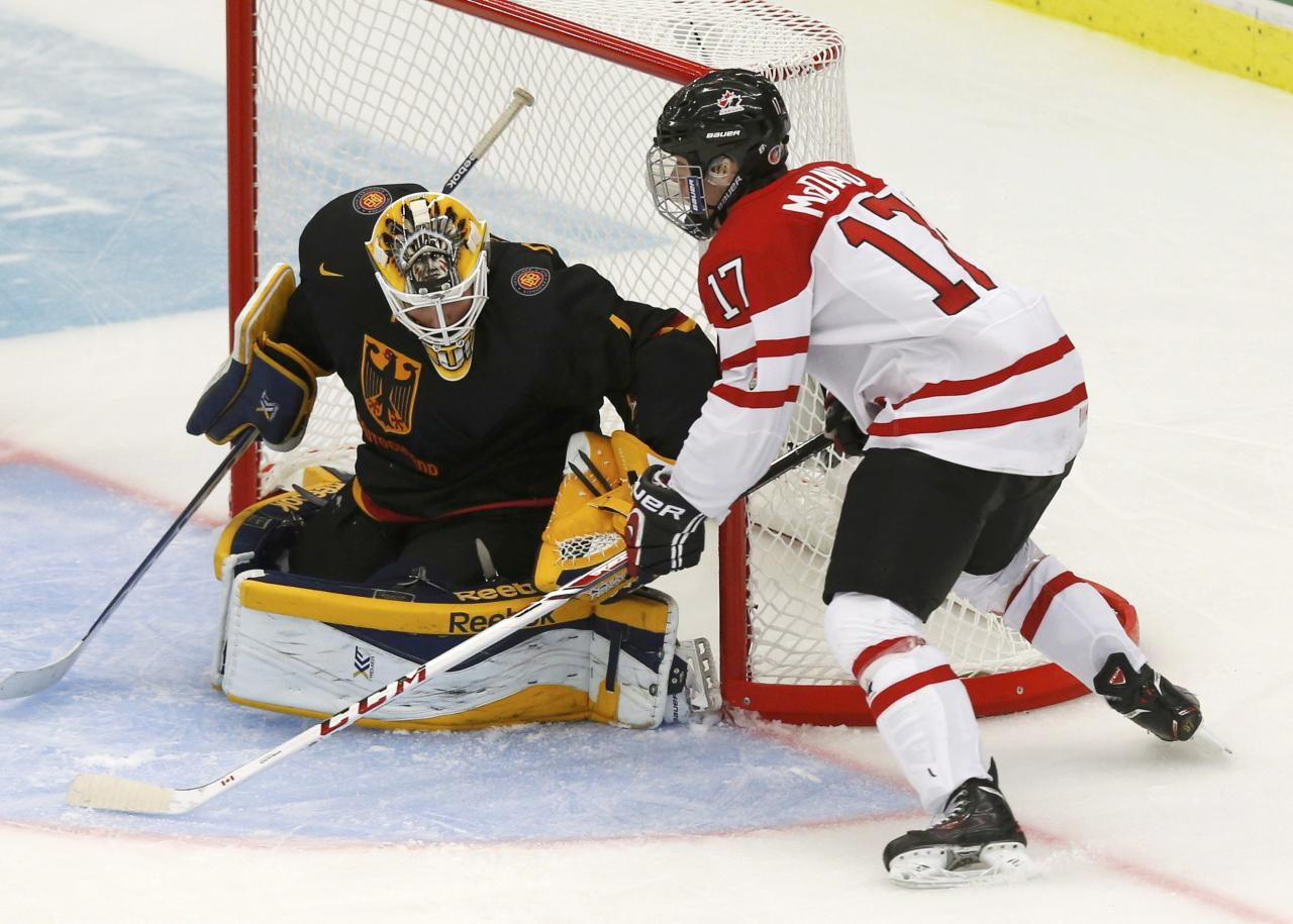 Canada's Connor McDavid scores on Germany's goalie Marvin Cupper during the third period of their IIHF World Junior Championship ice hockey game in Malmo, Sweden, December 26, 2013. REUTERS/Alexander Demianchuk (SWEDEN - Tags: SPORT ICE HOCKEY)