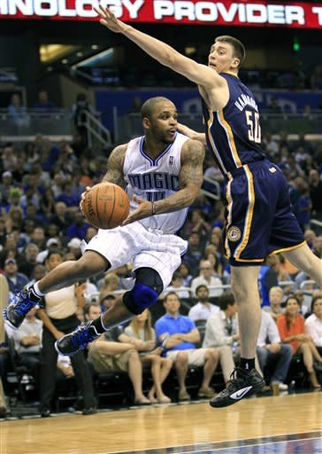 Orlando Magic's Jameer Nelson (14) looks to pass the ball as he gets around Indiana Pacers' Tyler Hansbrough (50) during the first half of Game 4 of an NBA first-round playoff basketball series, Saturday, May 5, 2012, in Orlando, Fla. (AP Photo/John Raoux)