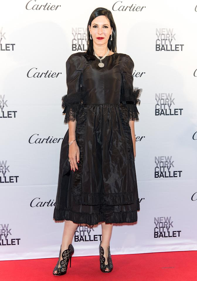 <p>The author, writer, and actress opted for a calf-length black dress with a tiered, ruffled skirt. It was made even more fun by the three-quarter length poufy sleeves. (Getty Images)</p>
