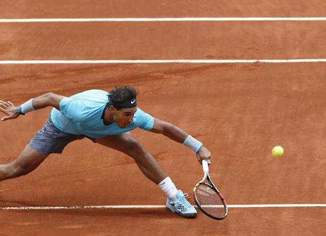 Spain's Rafael Nadal returns the ball to Austria's Dominic Thiem during the second round match of the French Open tennis tournament at the Roland Garros stadium, in Paris, France, Thursday, May 29, 2014. Nadal won 6-2, 6-2, 6-3. (AP Photo/Darko Vojinovic)