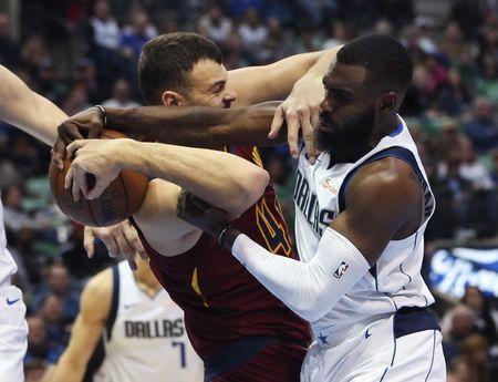 Mar 16, 2019; Dallas, TX, USA; Dallas Mavericks guard Tim Hardaway Jr. (11) and Cleveland Cavaliers center Ante Zizic (41) go for a loose ball during the first half at American Airlines Center. Mandatory Credit: Kevin Jairaj-USA TODAY Sports