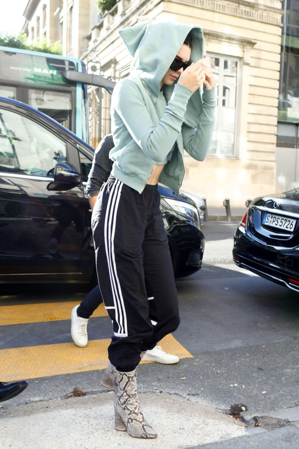 <p>The model showed off her toned stomach in a mint-green hoodie and tracksuit bottoms in Paris</p>