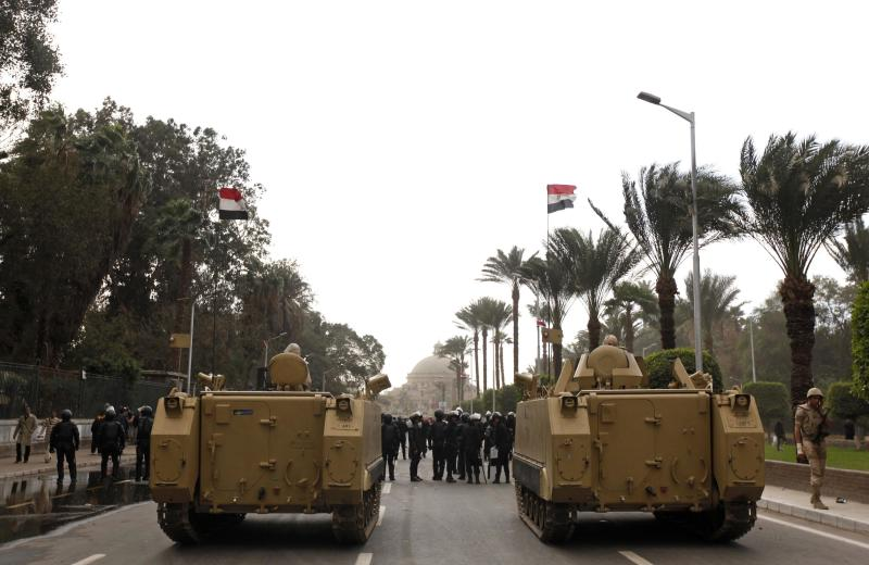 Army vehicles are parked outside Cairo university during clashes between riot policemen and Cairo University students, who are supporters of the Muslim Brotherhood and ousted Egyptian President Mursi, in Cairo