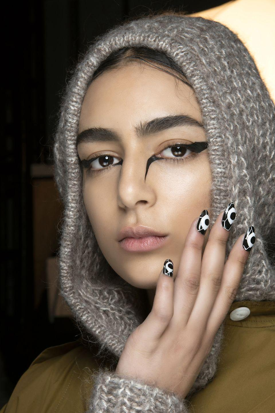 <p>Backstage at Rag and Bone's fall show, models showed off just how cool a black and white graphic manicure can look.</p>