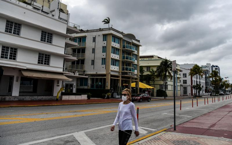 "A deserted street in Miami, Florida. Experts warn that the coronavirus could be ""endemic in our communities"" - CHANDAN KHANNA/AFP via Getty Images"