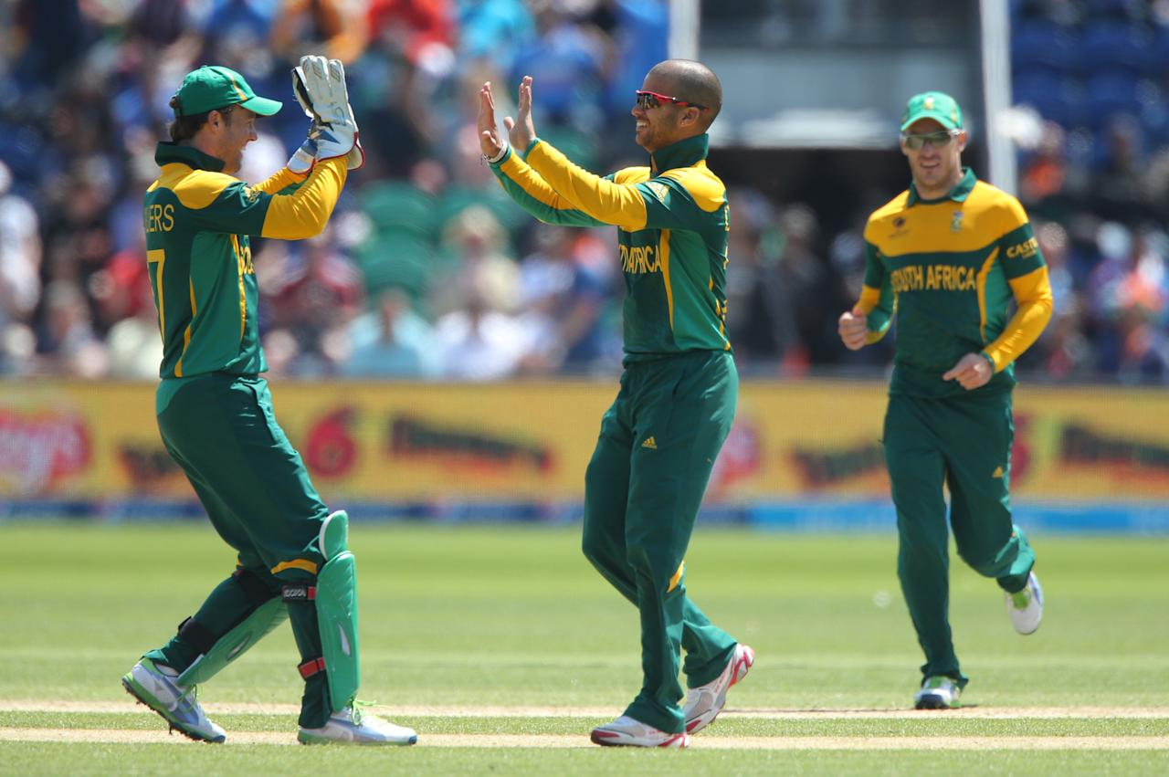 South Africa captain wicketkeeper AB De Villiers celebrates (left) with J-P Duminy during the ICC Champions Trophy match at the SWALEC Stadium, Cardiff.