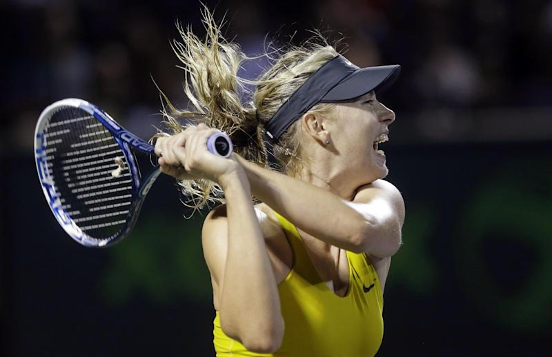 Maria Sharapova, of Russia, returns a shot from Lucie Safarova, of the The Czech Republic, at the Sony Open tennis tournament, Saturday, March 22, 2014, in Key Biscayne, Fla. (AP Photo/Wilfredo Lee)