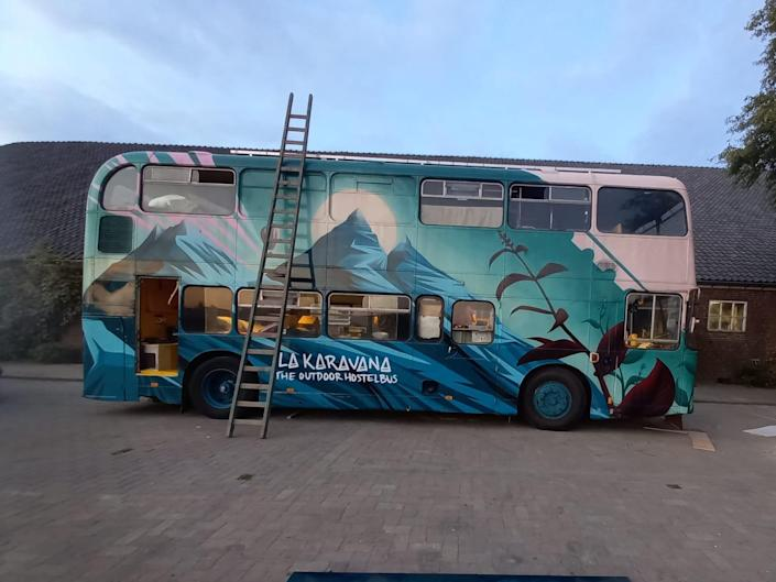 La Karavana bus after it was painted with mountains