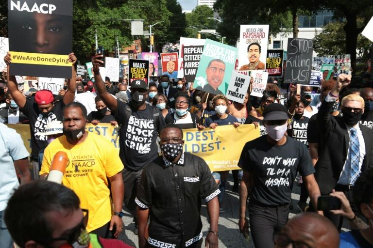 Protesters gather for a march organized by the National Association for the Advancement of Colored People (NAACP) in Atlanta, Georgia, to protest the fatal shooting of a black man by a white police officer (AFP Photo/Wes BRUER)