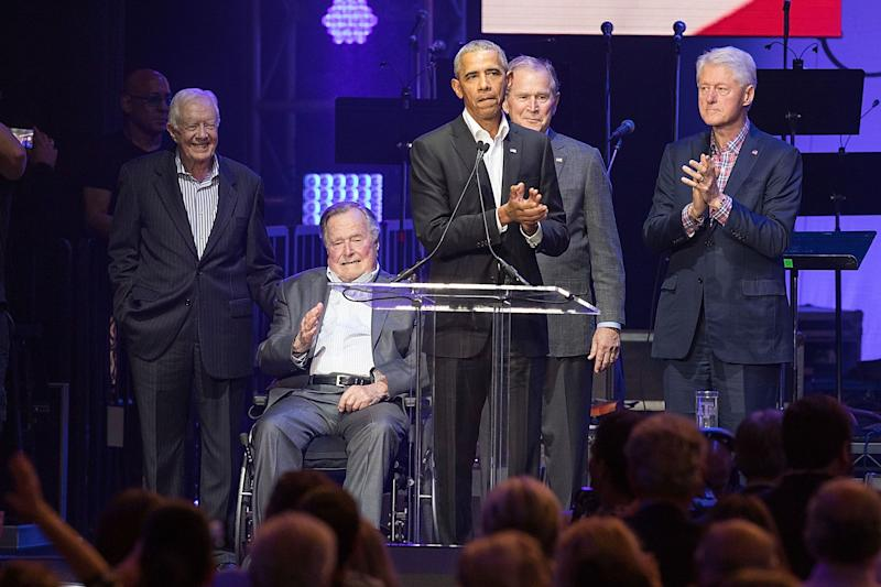 Former United States Presidents Jimmy Carter, George H.W. Bush, Barack Obama, George W. Bush, and Bill Clinton address the audience during the 'Deep from the Heart: The One America Appeal Concert' at Reed Arena on the campus of Texas A&M University on October 21, 2017 in College Station, Texas.