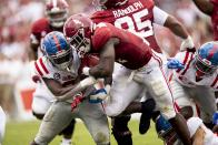 Alabama running back Brian Robinson Jr. (4) runs by Mississippi linebacker Lakia Henry (0) during the first half of an NCAA college football game, Saturday, Oct. 2, 2021, in Tuscaloosa, Ala. (AP Photo/Vasha Hunt)