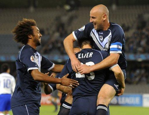 Melbourne Victory's Adrian Leijer (C), Isaka Cernak-Okanya (L) and Kevin Muscat (R)