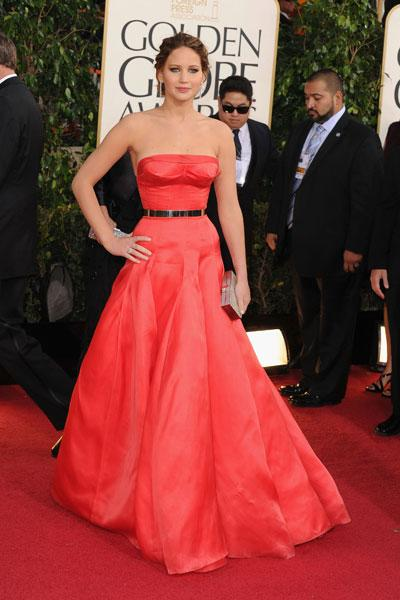 "Jennifer Lawrence: This Dior Haute Couture dress reminds us of the <a href=""http://ca.shine.yahoo.com/photos/jennifer-lawrence-s-best-looks-slideshow/"">slinky red Calvin Klein</a>  Jennifer wore to the 2011 Oscars, not so much because of the colour but  because of the excitement it brought out of us. The 'Silver Linings  Playbook star' and Golden Globe and Oscar nominee is a knockout in the  strapless number. The gold belt pulls the look together and makes it  look young and modern. (Photo by Steve Granitz/WireImage)"