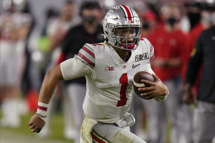 Justin Fields is one of the five quarterbacks very likely to go in the first round. (AP Photo/Chris O'Meara, File)