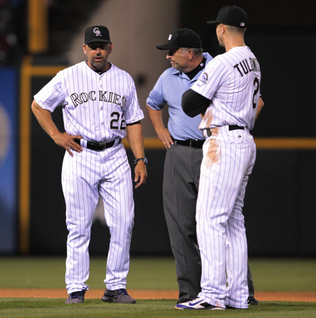 Colorado Rockies manager Walt Weiss (22) challenges a call with umpire Dale Scott in the seventh inning of a baseball game against the Los Angeles Dodgers in Denver on Friday, June 6, 2014. Dodgers base runner was ruled out at second base, reversing the call on the field, by a tag from Colorado Rockies shortstop Troy Tulowitzki (2). (AP Photo/Joe Mahoney)