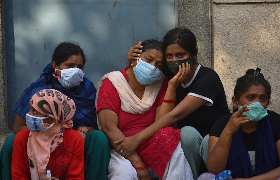 Grieving family members of COVID-19 victims at a cremation ground in New Delhi, India, 29 April 2021