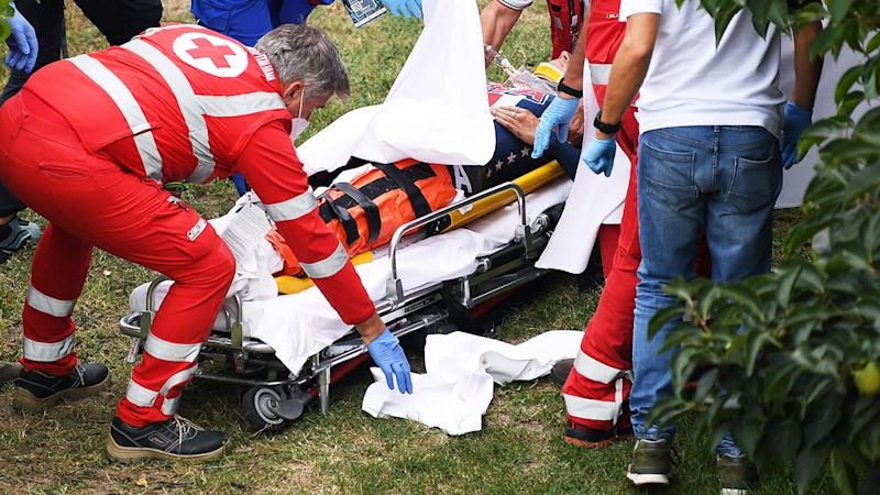 Chloe Dygert, pictured here being treated by medics after her crash.