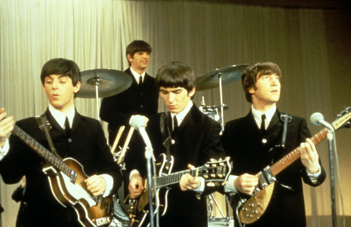 The Beatles performing on stage, circa 1963. Left to right: Paul McCartney, Ringo Starr, George Harrison (1943 - 2001) and John Lennon (1940 - 1980). (Photo by King Collection/Photoshot/Getty Images)