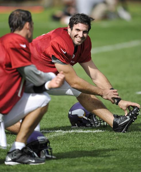 Vikings quarterbacks Matt Cassel, left, and Christian Ponder stretch during their football practice at the Grove Hotel in Watford, England, Thursday Sept. 26, 2013. The Pittsburgh Steelers are to play the Minnesota Vikings in the NFL International Series at Wembley Stadium in London on Sunday, Sept 29. (AP Photo/Sean Ryan, NFL)