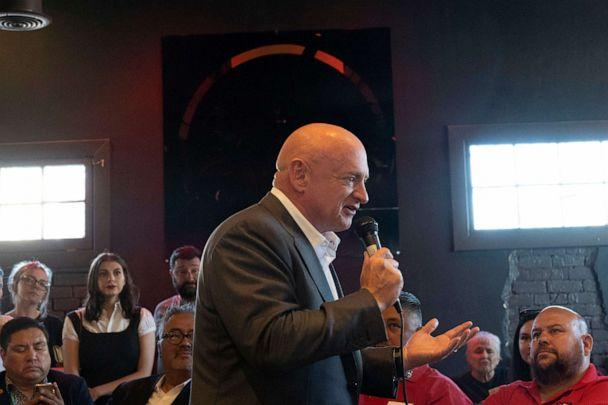 PHOTO: Mark Kelly speaks to the crowd during his campaign event at Tres Leches Cafe in Phoenix, May 30, 2019. (Nick Oza/The Republic via USA Today Network, FILE)