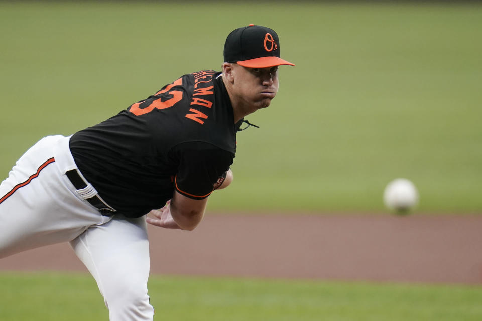 Baltimore Orioles starting pitcher Thomas Eshelman throws a pitch to the Toronto Blue Jays during the first inning of a baseball game, Friday, June 18, 2021, in Baltimore. (AP Photo/Julio Cortez)