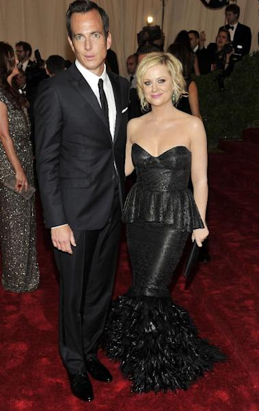 FILE - This May 7, 2012 file photo shows actors Will Arnett and Amy Poehler arriving at the Metropolitan Museum of Art Costume Institute gala benefit in New York. The couple is separating after 9 years of marriage, their publicist Lewis Kay confirmed Thursday, Sept. 6. Poehler and Arnett have two young sons, 3-year-old Archie and 2-year-old Abel. (AP Photo/Charles Sykes, file)