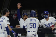 Los Angeles Dodgers' Mookie Betts celebrates after scoring against the Tampa Bay during the sixth inning in Game 6 of the baseball World Series Tuesday, Oct. 27, 2020, in Arlington, Texas. (AP Photo/Tony Gutierrez)