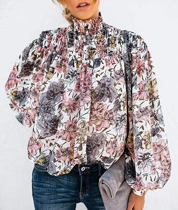 """<p>This chic <a href=""""https://www.popsugar.com/buy/Kufv-Floral-Print-Blouse-506841?p_name=Kufv%20Floral%20Print%20Blouse&retailer=amazon.com&pid=506841&price=19&evar1=fab%3Aus&evar9=46805128&evar98=https%3A%2F%2Fwww.popsugar.com%2Fphoto-gallery%2F46805128%2Fimage%2F46806288%2FKufv-Floral-Print-Blouse&list1=shopping%2Cfall%20fashion%2Camazon%2Ctops&prop13=api&pdata=1"""" rel=""""nofollow"""" data-shoppable-link=""""1"""" target=""""_blank"""" class=""""ga-track"""" data-ga-category=""""Related"""" data-ga-label=""""https://www.amazon.com/KUFV-Womens-Floral-Turtleneck-Sleeve/dp/B07WPKN49L?ref_=ast_bbp_dp&amp;th=1&amp;psc=1"""" data-ga-action=""""In-Line Links"""">Kufv Floral Print Blouse</a> ($19) comes in a few different patterns.</p>"""