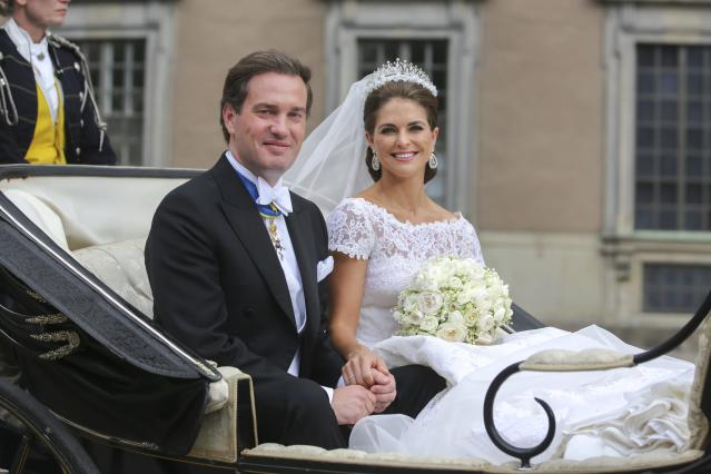 Princess Madeleine of Sweden and Christopher O´Neill leave in an open carriage after their wedding ceremony at the royal chapel in Stockholm Saturday June 8, 2013. (AP Photo/Soren Andersson) SWEDEN OUT