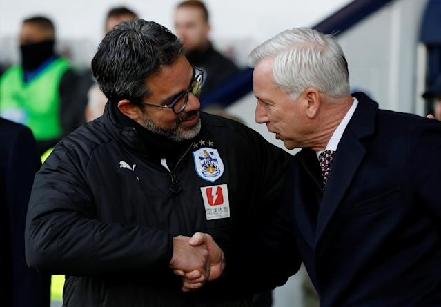 "Soccer Football - Premier League - West Bromwich Albion vs Huddersfield Town - The Hawthorns, West Bromwich, Britain - February 24, 2018 Huddersfield Town manager David Wagner shakes hands with West Bromwich Albion manager Alan Pardew before the match Action Images via Reuters/Paul Childs EDITORIAL USE ONLY. No use with unauthorized audio, video, data, fixture lists, club/league logos or ""live"" services. Online in-match use limited to 75 images, no video emulation. No use in betting, games or single club/league/player publications. Please contact your account representative for further details."