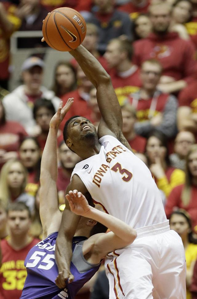 Iowa State forward Melvin Ejim (3) is fouled by Kansas State guard Will Spradling, left, while catching a pass during the first half of an NCAA college basketball game, Saturday, Jan. 25, 2014, in Ames, Iowa. (AP Photo/Charlie Neibergall)