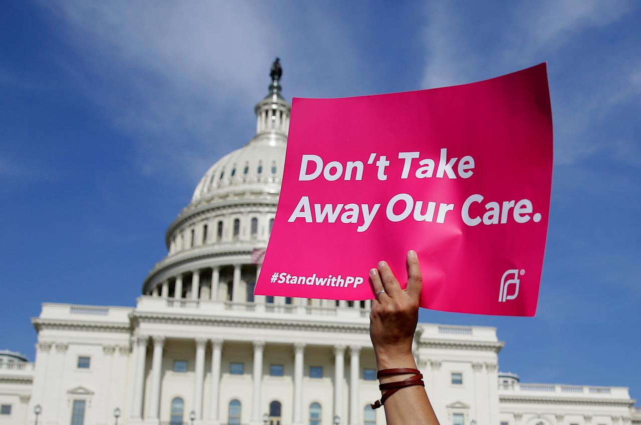 Healthcare activists with Planned Parenthood and the Center for American Progress protest in opposition to the Senate Republican healthcare bill on Capitol Hill in Washington, U.S., June 28, 2017.   REUTERS/Joshua Roberts