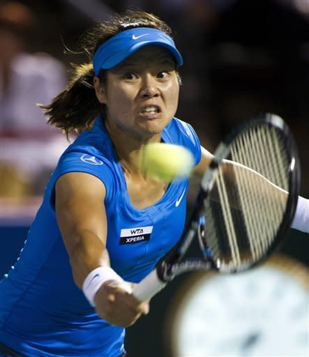 Li Na, from China, returns to Petra Kvitova, from the Czech Republic, during the final match at the Rogers Cup women's tennis tournament, Monday, Aug. 13, 2012, in Montreal. (AP Photo/The Canadian Press, Paul Chiasson)
