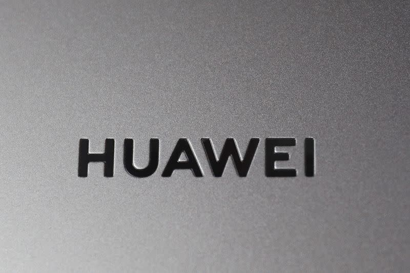 A Huawei logo is seen on a device at a media event in London