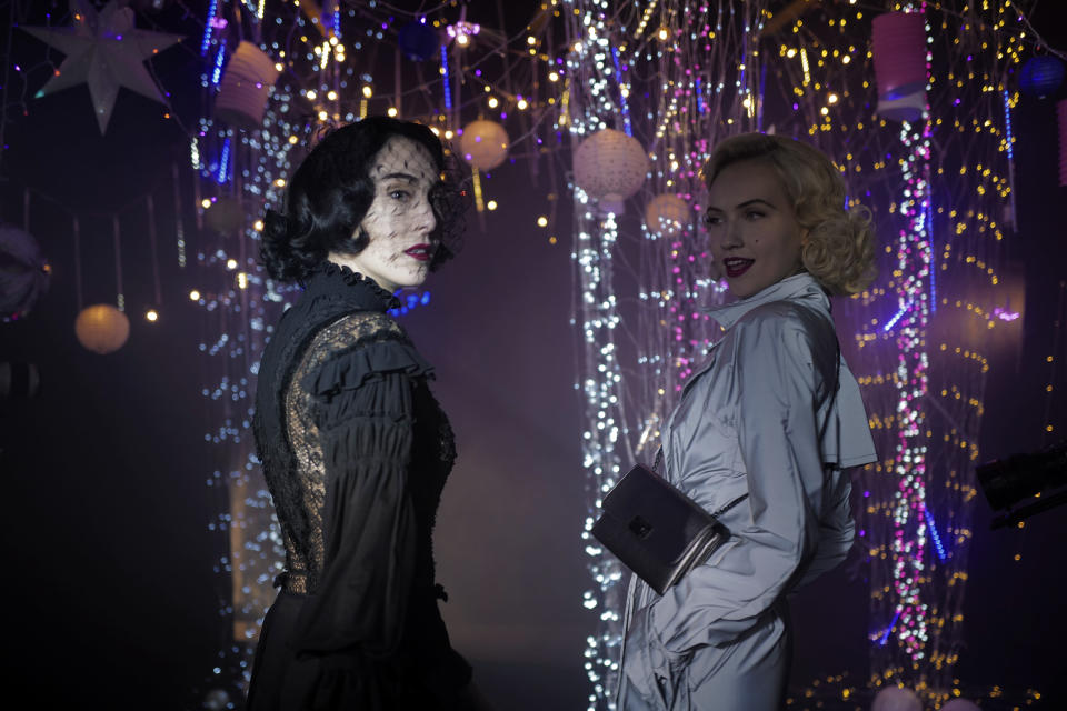 Models Angeliki Tsionou, left Michaela Tomanova, right, display creations by Julien Fournie for his Haute Couture Spring/Summer 2021 fashion collection for a digital presentation of the fashion week, in Paris, Thursday, Jan. 7, 2021. With shows taking place behind closed doors due to the virus pandemic, some designers such as Julien Fournie are becoming versatile: Getting their designs out to the public by making a film of their collection and streaming it online. (AP Photo/Francois Mori)