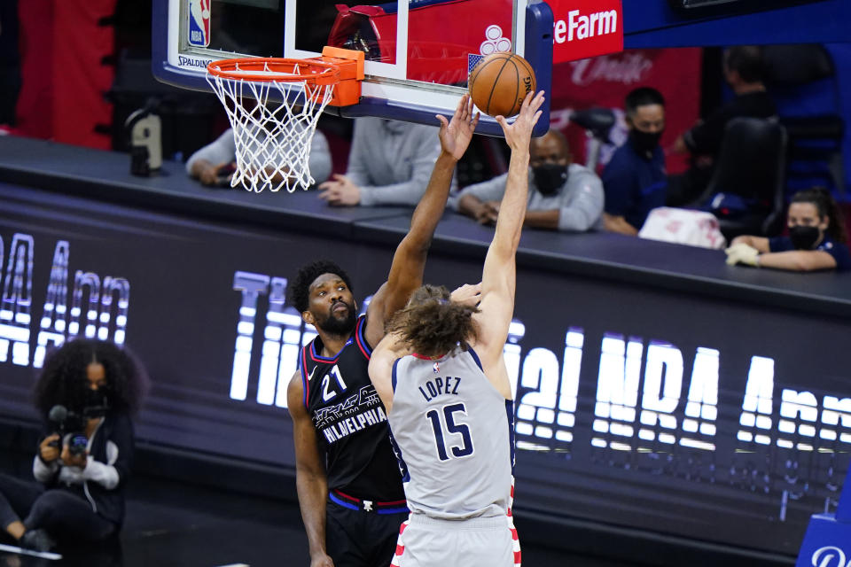 Philadelphia 76ers' Joel Embiid, left, tries to block a shot by Washington Wizards' Robin Lopez during the first half of Game 2 in a first-round NBA basketball playoff series, Wednesday, May 26, 2021, in Philadelphia. (AP Photo/Matt Slocum)