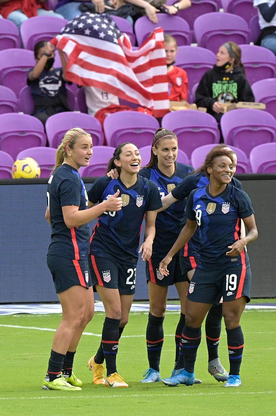 United States forward Christen Press, second from left, is congratulated by teammates Lindsey Horan, left, Alex Morgan, and Crystal Dunn (19) after Press scored a goal during the first half of a SheBelieves Cup match against Brazil on Sunday, Feb. 21.