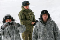 Russian officers look at international journalists who arrived on the Alexandra Land island near Nagurskoye, Russia, Monday, May 17, 2021. Once a desolate home mostly to polar bears, Russia's northernmost military outpost is bristling with missiles and radar and its extended runway can handle all types of aircraft, including nuclear-capable strategic bombers, projecting Moscow's power and influence across the Arctic amid intensifying international competition for the region's vast resources. (AP Photo/Alexander Zemlianichenko)