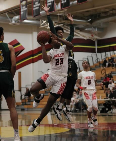 RANCHO CUCAMONGA, CA - MAY 7, 2021: Etiwanda Marcus Green (23) drives to the basket against Damien Chris Nickelberry (3) in the first half at Etiwanda High School on May 7, 2021 in Rancho Cucamonga, California.(Gina Ferazzi / Los Angeles Times)