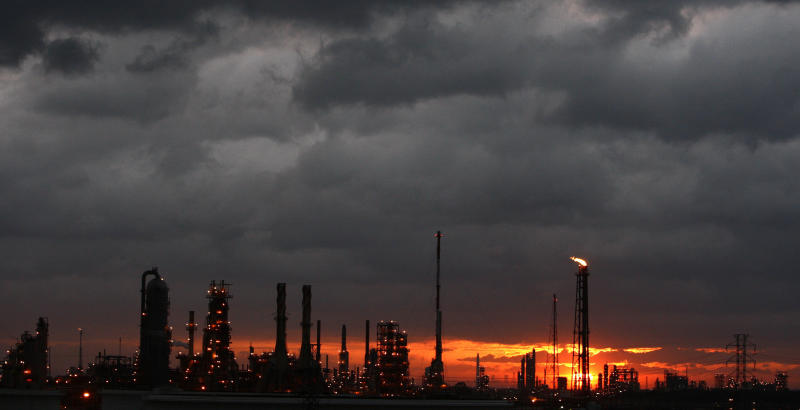 Dark clouds gather over a refinery near Houston as Hurricane Ike approaches on Sept. 12, 2008.