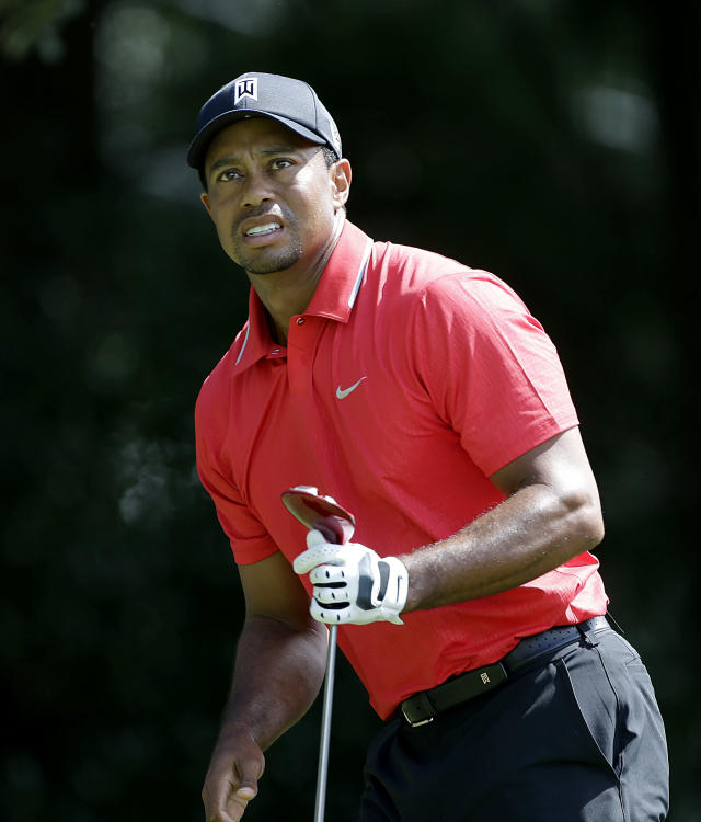 Tiger Woods watching his tee shot off the third hole during the final round of play in the Tour Championship golf tournament at East Lake Golf Club, in Atlanta, Sunday, Sept. 22, 2013. (AP Photo/John Bazemore)