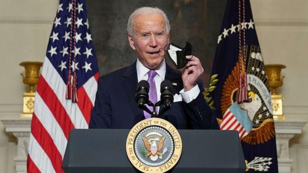 PHOTO: President Joe Biden holds up a face mask as he speaks about the fight to contain the coronavirus disease (COVID-19) pandemic, at the White House in Washington, Jan. 26, 2021. (Kevin Lamarque/Reuters)