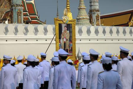 Royal officials pay their respect to a picture of Thailand's King Maha Vajiralongkorn during a procession to deliver from Wat Suthat to the Grand Palace to be consecrated for his upcoming coronation ceremony in Bangkok, Thailand, April 19, 2019. REUTERS/Athit Perawongmetha/File Photo
